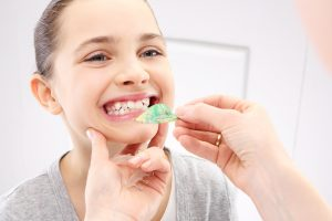 The Link Between Digestive Problems and Crooked Teeth