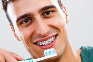 Guide To Flossing And Maintaining Oral Hygiene With Braces